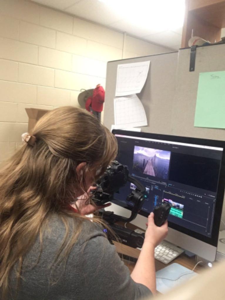 Emily Stine working with AV equipment
